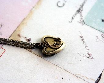moon star. locket necklace. in brass ox