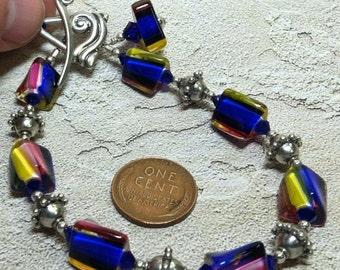 handmade OOAK art glass, crystals, sterling bracelet pink blue yellow stripes