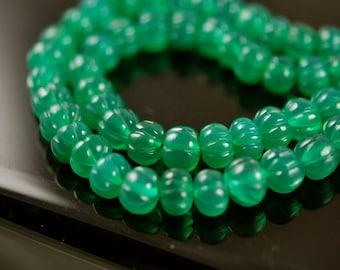 1/2 strand -- carved green onyx roundeles