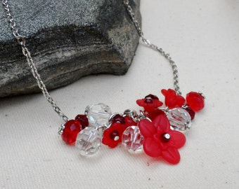 Cluster of Red and Clear Glass with Plastic Flowers - A Beaded Necklace