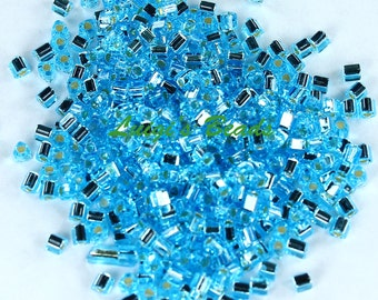 11/0 Triangle Toho Glass Seed Beads #23-Silver-Lined Aquamarine 15g