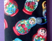 Russian doll passport cover made with a rare fabric with a button elastic loop closure