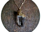 quartz crystal necklace on delicate gold plated chain -