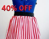40% off. Red and white candy stripe skirt, elasticated waist. Size UK 10/12 available