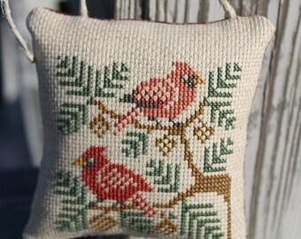 Completed Cross Stitch Cardinals in Pine Boughs Door Hanger/Ornament