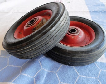 Set of two vintage wagon tires, red metal interior, black rubber, wheels