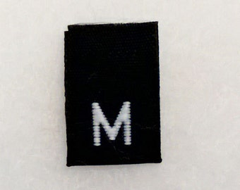 Size M (Medium) Woven Clothing Size Tags (Package of 500)- BLACK Background