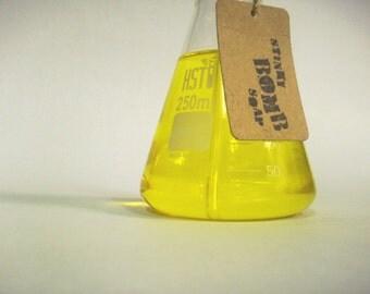 Lemon hand soap in science flask