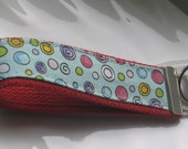 Bubbles Handless Fab Fob. Dr. Suess looking Fabric. Light blue background.