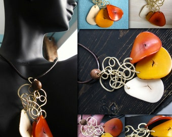 Tagua Nut Slices and Brass Pendant Necklace. LYNDON. burnt orange. ivory. mango with solid brass Chandelier Style. pendant necklace