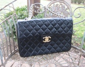 Large Vintage black Chanel flap bag with gold chain strap.