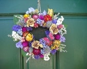 Small Handmade colorful spring dried flower garden wreath with butterfly.