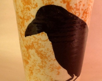 Black crow black raven hand thrown stoneware cup yellow background