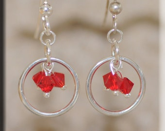Silver Loops with Red Crystals