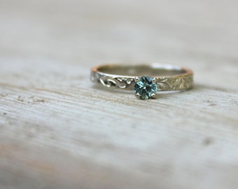ethical fair trade sea foam Montana sapphire engagement ring . recycled 14k white gold vine band . prong setting . made to order