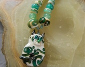 Lampwork Bead Set, Scrolled Flat Cat Focal Bead Pendant and Matching Spacer Beads: Cat Reaction