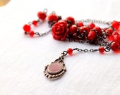 Red and Black long rosario necklace with red flower and crystals and a vintage pendant.