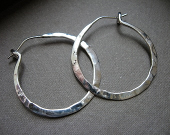 Simple light weight hoop in sterling silver