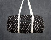Quilted Duffle bag in Black with Cream Floral Print.