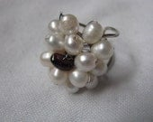 White beaded faux pearl scarf ring with purple center and silver tone setting