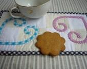 Mug Rug Celtic bias strip applique hearts hand quilted pink teal black checked