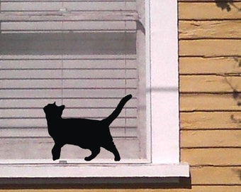 When a cat is walking along a windowsill Black Cat Vinyl Wall Decal Sticker
