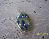 Reserved for Tami  ------------------------------- sterling silver wire sculpted pendant