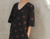 Cotton black dress with red abstract ornament and pockets