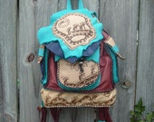 Unique one of a kind Leather Backpack / Purse with Kokapelli designs on the bag