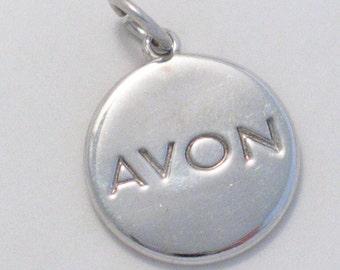 Sterling silver charm pendant 4 necklace bracelet AVON 2004 disc tag collectors item womens makeup fine jewelry