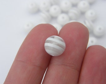 100 Clear and white striped resin beads B87