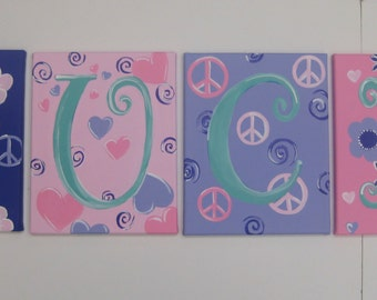 Four hand painted canvas letters peace signs,hearts, flowers,pink, purple,turquoise,girls letters,childrens letters,kids letters,nursery art