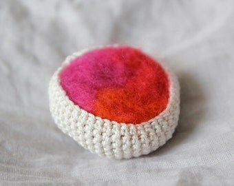 Crochet and felt brooch with milky-white cotton thread and hot-pink red-orange wool
