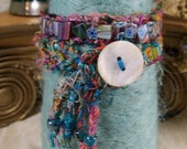 Wrap bracelet in candy glass with silk cording.