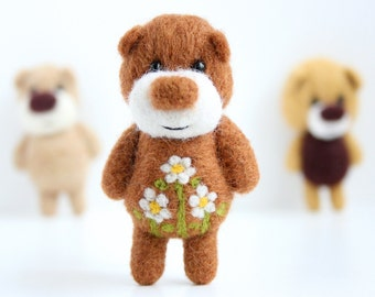 Felted light brown miniature pocket bear woth flowers