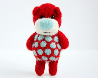 Red miniature felted pocket bear woth blue polka dots