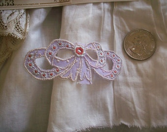 Darling hand done bow appliques in lavender never used