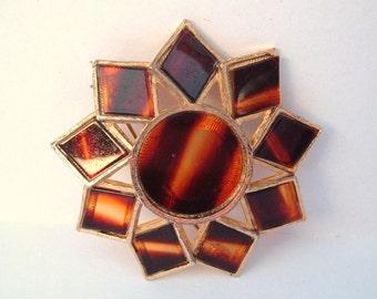 Brown plastic sunburst flower vintage brooch