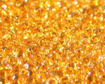 10 grams of 2,5 mm x 5,0 mm sized Medium Topaz SuperDuo two hole beads (SD026)