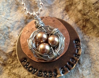 Hand stamped birds nest necklace