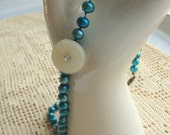 Peacock blue pearl necklace with vintage button