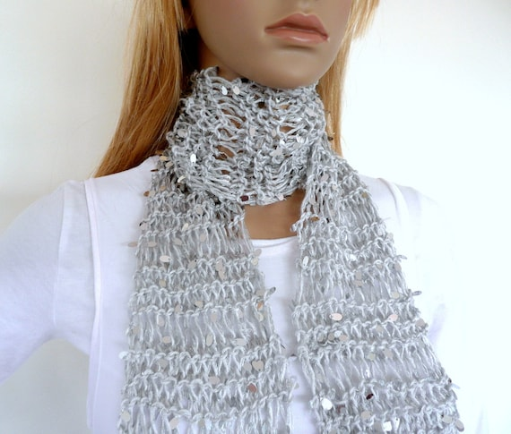 Hand knit scarf in silver sequin yarn with a tassel