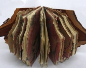 coptic bound journal with wooden covers and marbled and blank handmade paper pages