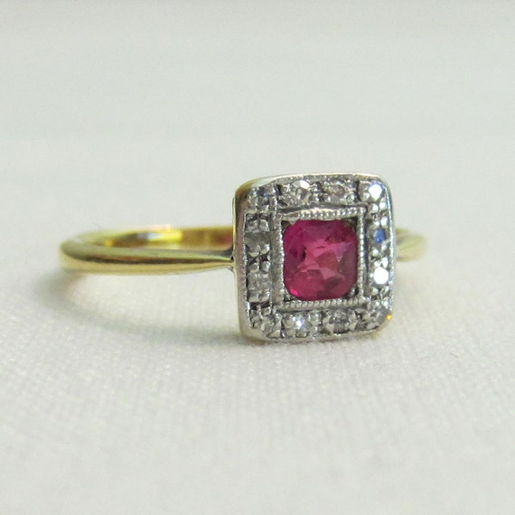 reserved antique ruby engagement ring with halo