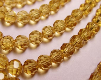 Crystal - round faceted 4mm beads - 98 beads - AA quality - golden yellow topaz - Full strand