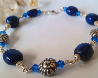 Deep Blue Lapis Lazuli and Fine Silver Swirly Gastropod Shell  Bracelet