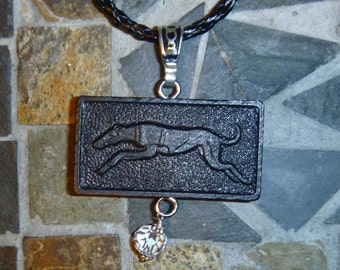 Vintage Greyhound domino necklace with crystal clear bead