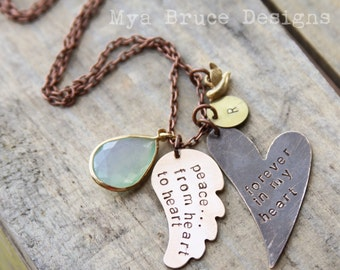 Forever in my heart. Long bronze heart with brass wing pendant, beautiful large green and gold teardrop crystal and mini gold bird