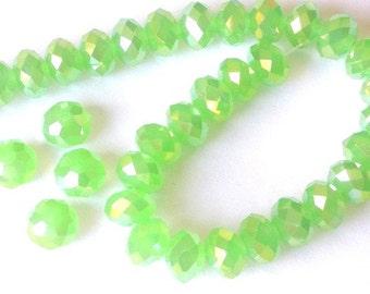 30 iridescent light green crystal beads, 6mm x 4mm