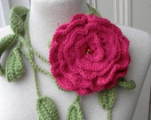 Crochet lariat with green leaves and  dark pink flower brooch